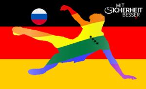 Silhouette eines Fussballspieler mit Regenbogenfarben auf Deutschlandfahne mit russischen Fussball